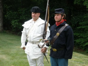 Rick fired the musket and William played Taps.
